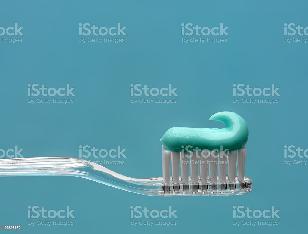 A toothbrush with blue toothpaste gel stock photo