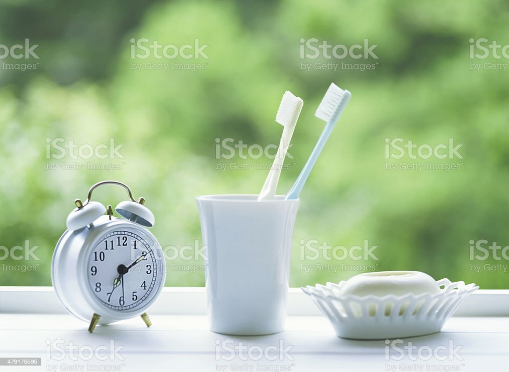 toothbrushes and alarm clock royalty-free stock photo