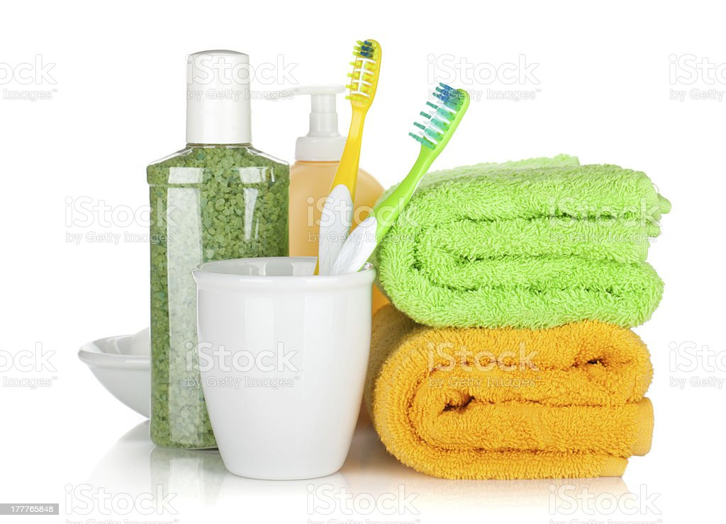 Toothbrushes, cosmetics bottles and two towels royalty-free stock photo