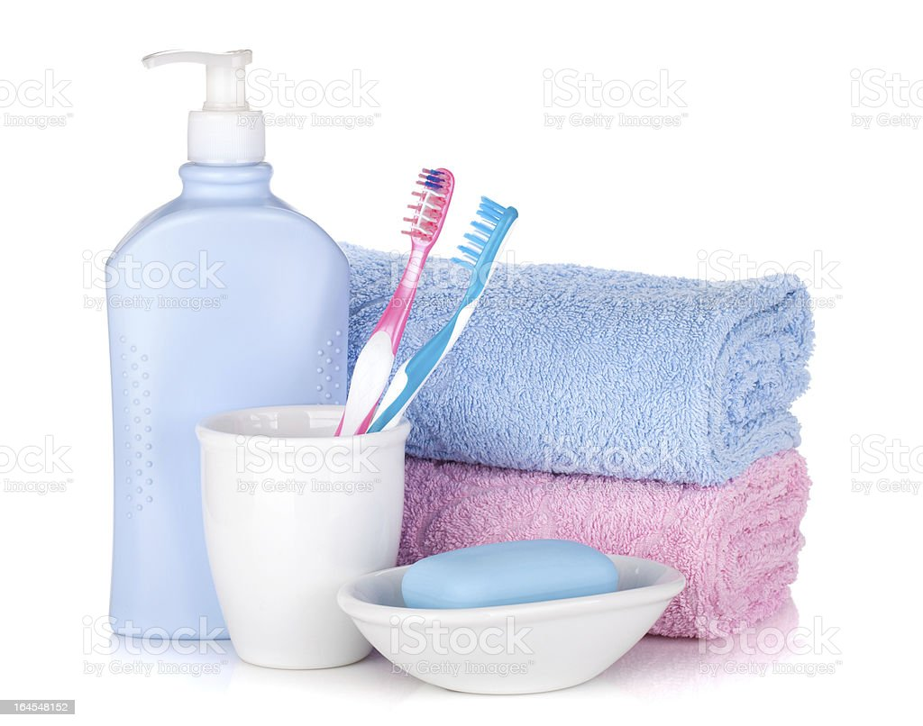 Toothbrushes, gel, soap and two towels royalty-free stock photo