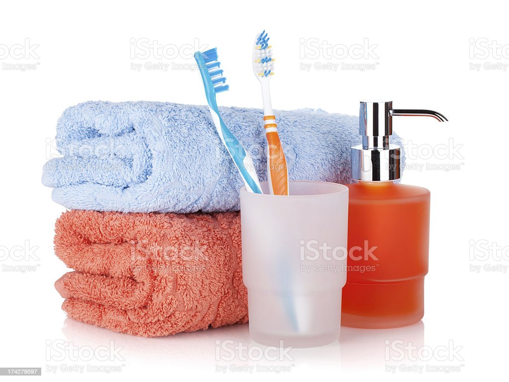 Toothbrushes, liquid soap and towels royalty-free stock photo
