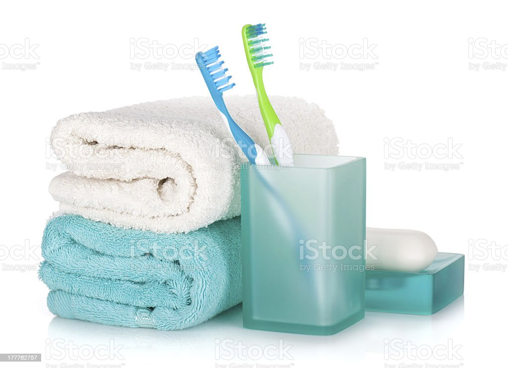 Toothbrushes, soap and two towels royalty-free stock photo