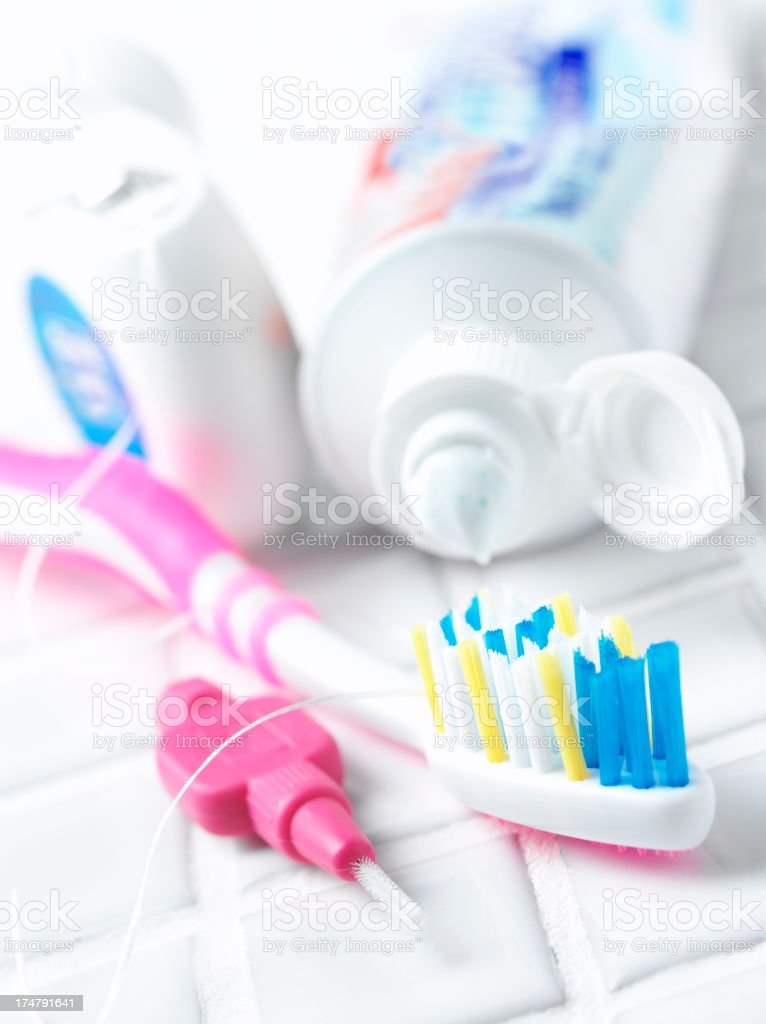 Toothpaste and Toothbrush on White Bathroom Tiles stock photo