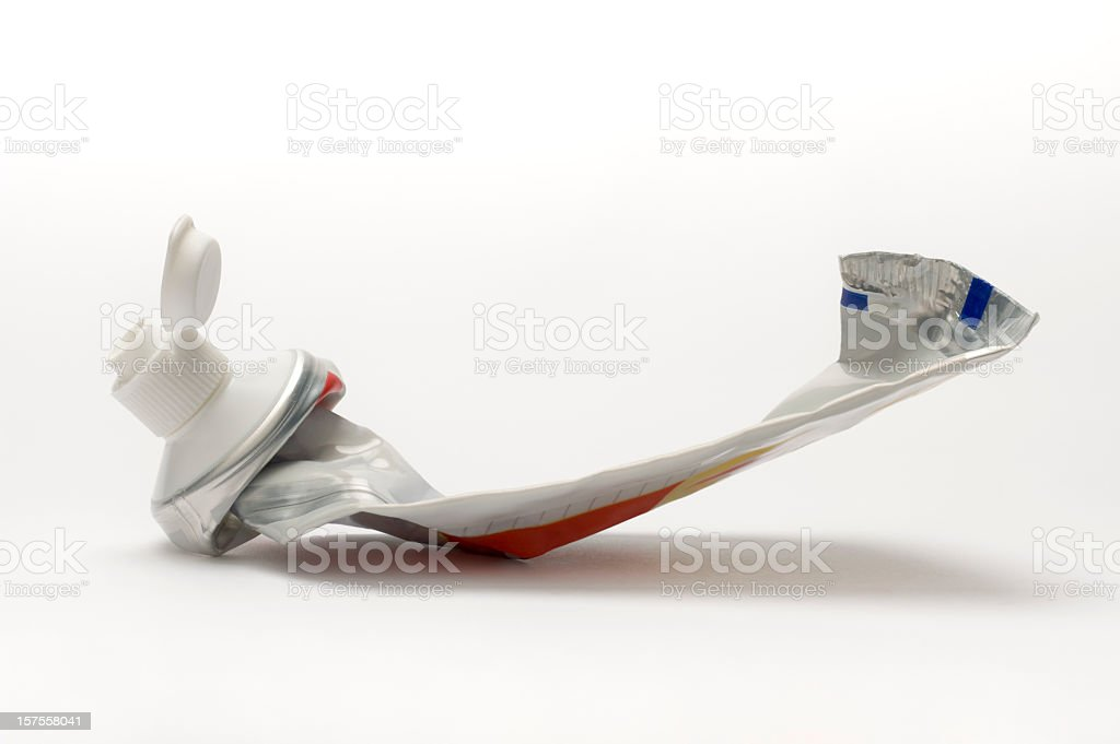 Toothpaste container squeezed empty on a white background stock photo