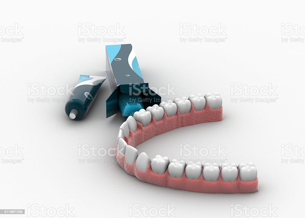 Toothpaste with artificial tooth stock photo