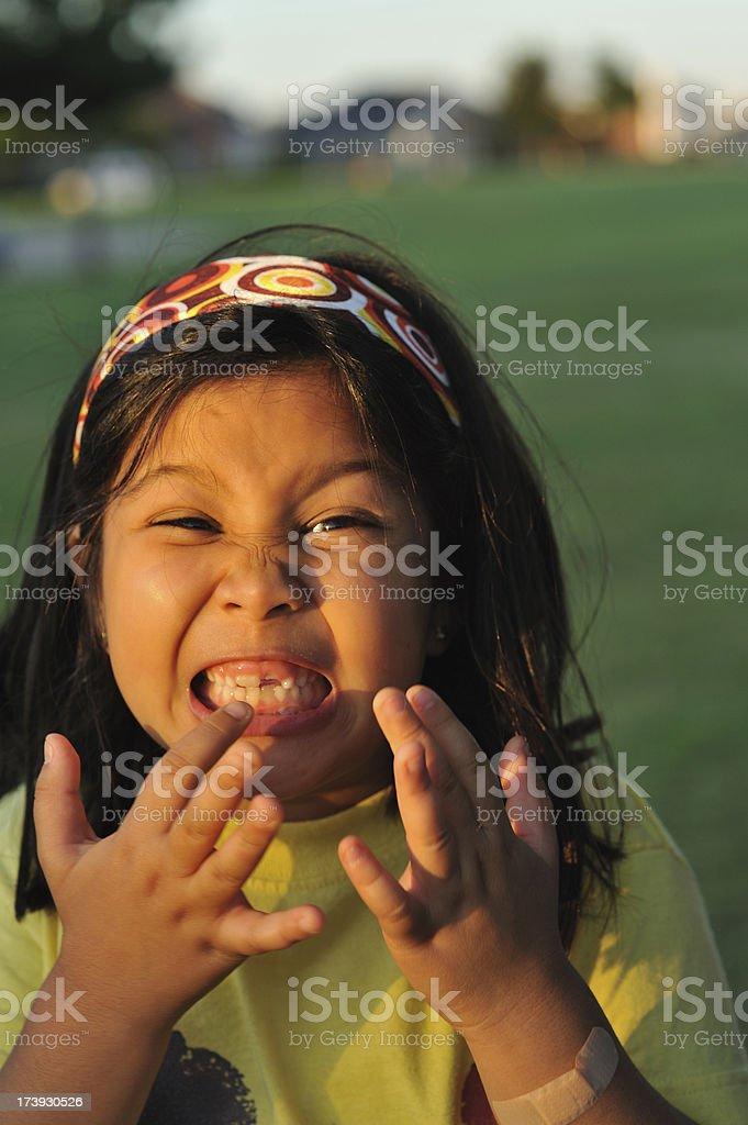 Toothy girl stock photo