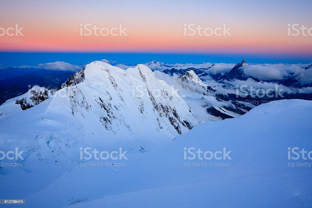 Top Alpine peaks right before sunrise stock photo