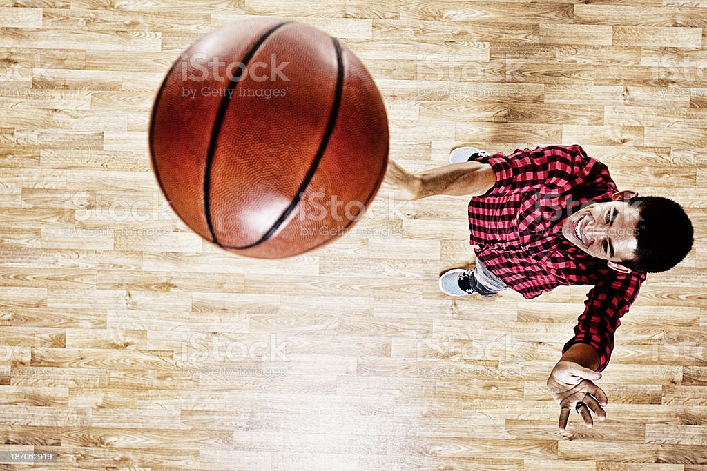 Top angle view of youngman playing basketball royalty-free stock photo