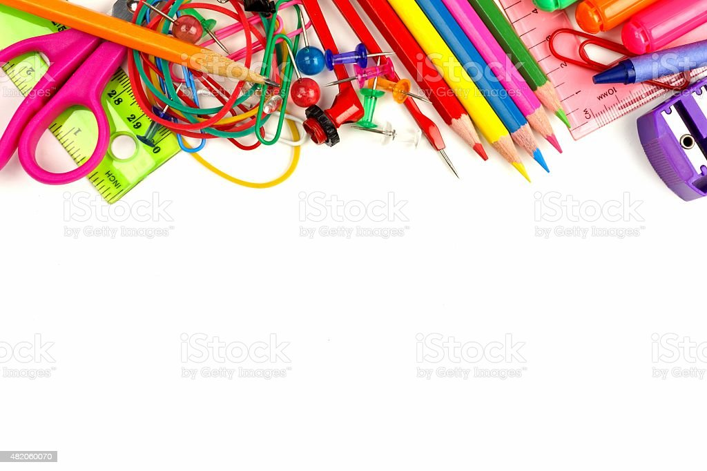 Top border of school supplies over white stock photo
