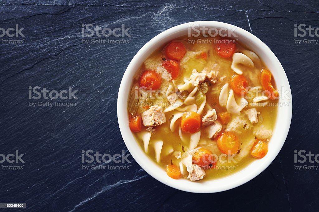 top down photo of chicken noodle soup stock photo