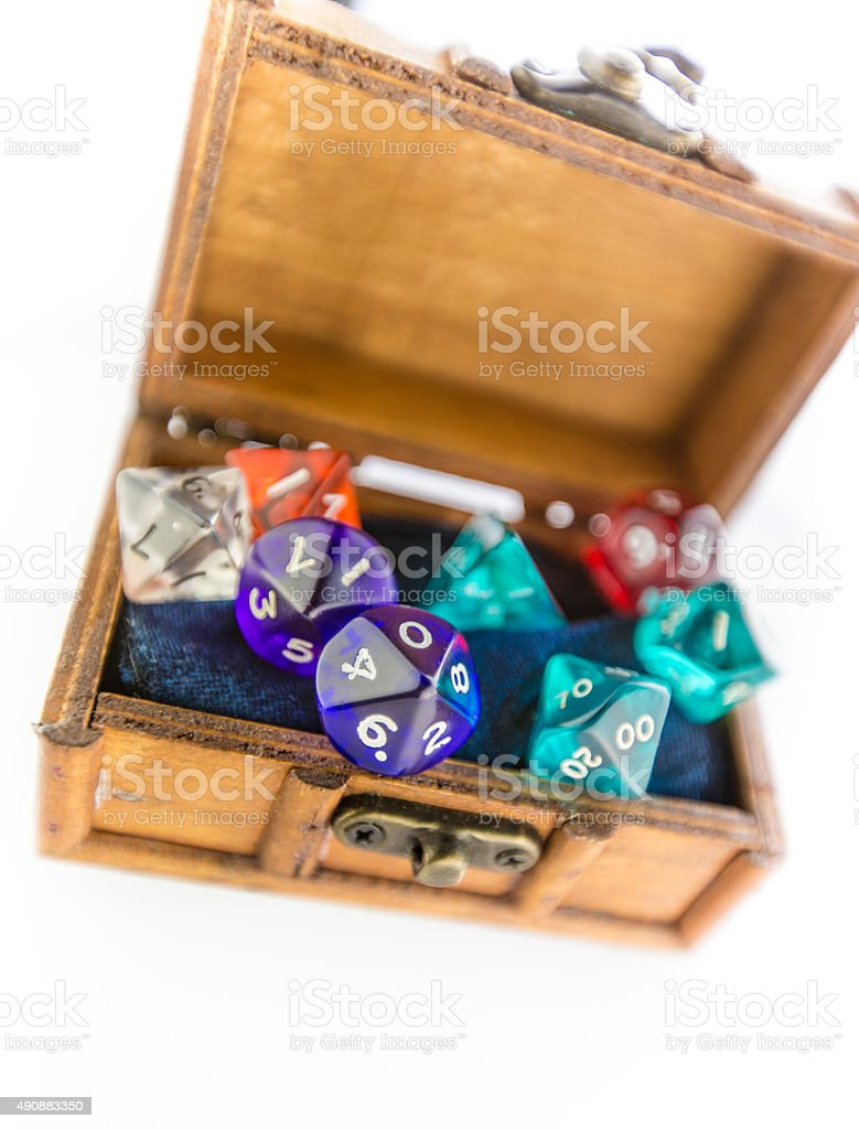 Top down shot of wooden chest containing dice set stock photo