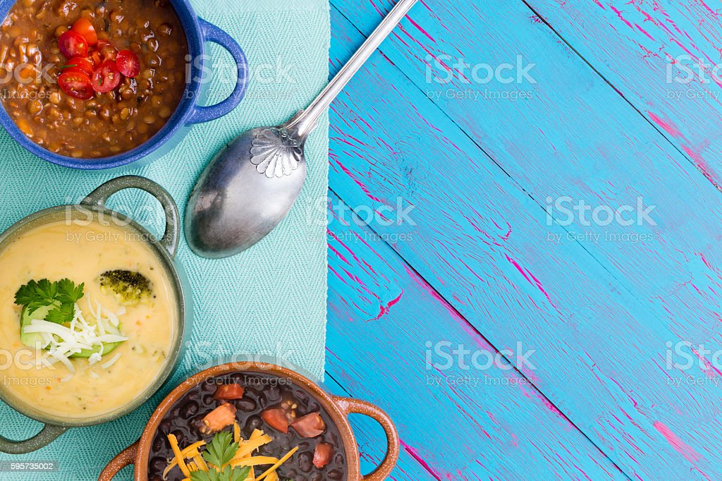 Top down view of bowls of soup stock photo