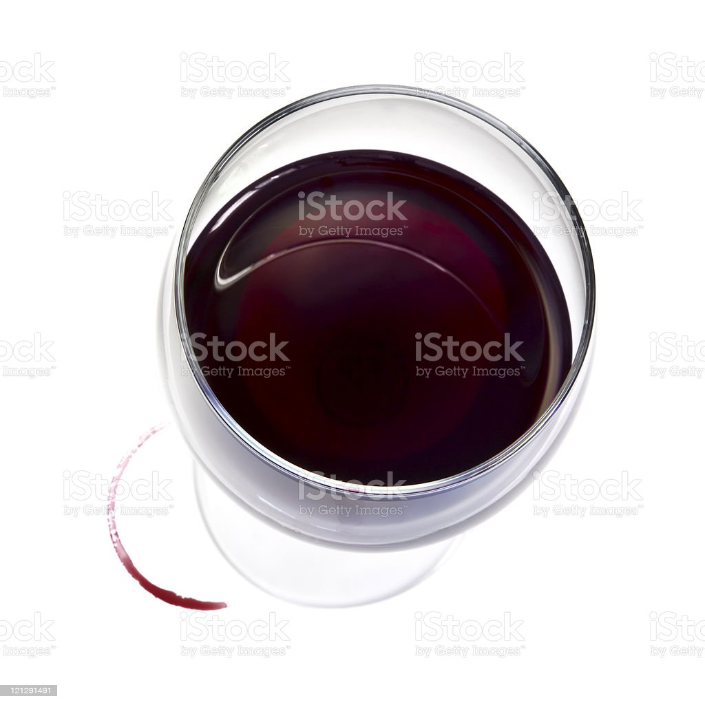 Top down view of glass of red wine with spill ring on white stock photo