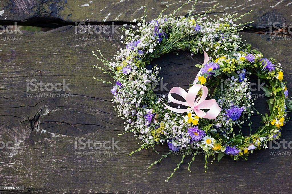 Top down view of handmade flower crowns at barn wedding. stock photo