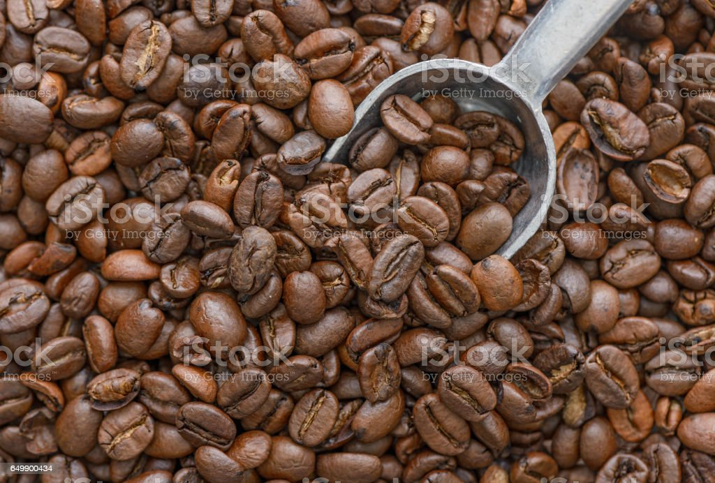 Top down view of whole coffee beans with a scoop stock photo