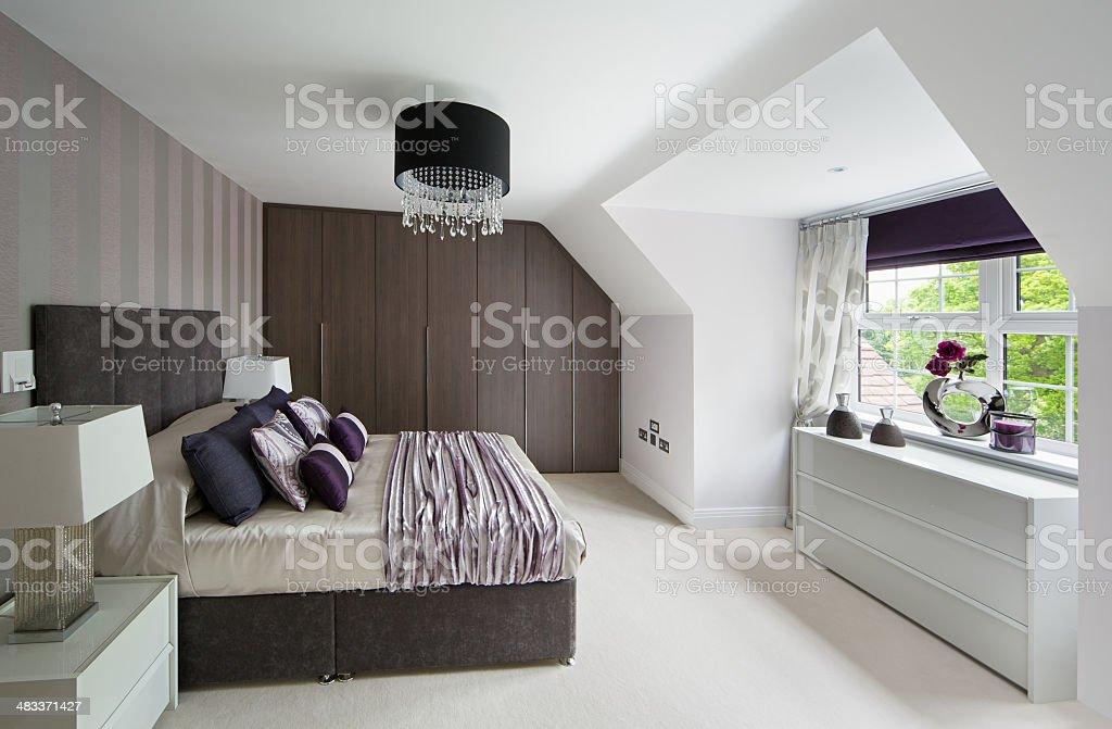 top floor apartment bedroom stock photo