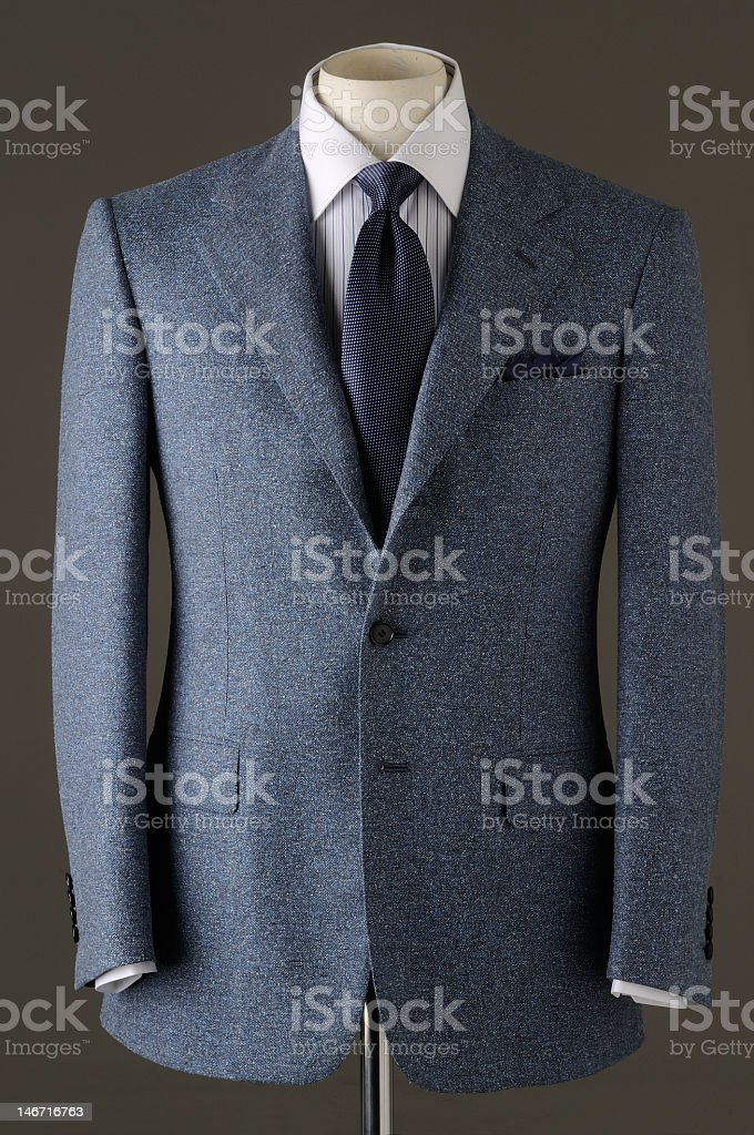Top half of a formal gray men's suit and tie stock photo