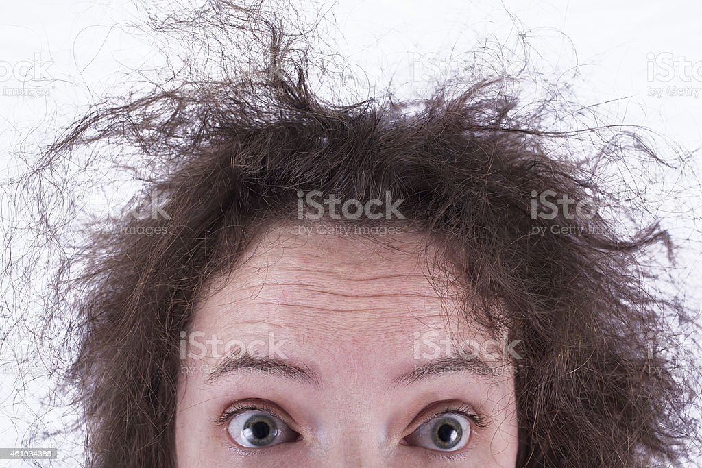 Top Half of Surprised Frizzy Haired Girls Head stock photo