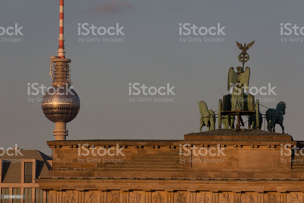 top of brandenburg gate and television tower stock photo