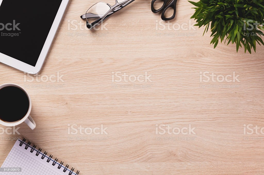 Top of desk with empty space and office equipment around. stock photo
