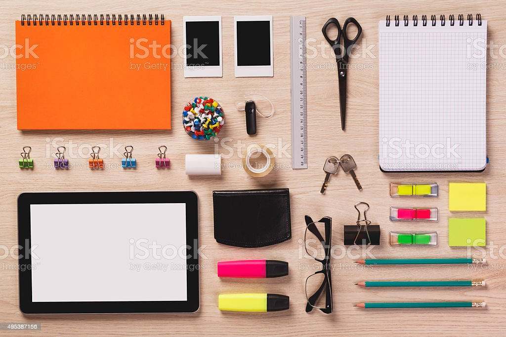 Top of desk with office equipment arranged if perfect order. stock photo