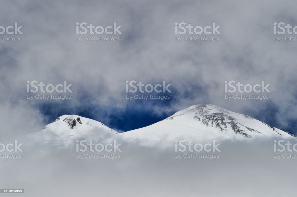 Top of Elbrus mountain covered by ice and snow stock photo