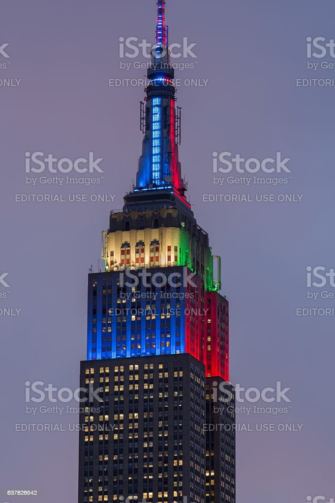 Top of Empire State Building in American and Christmas colors stock photo