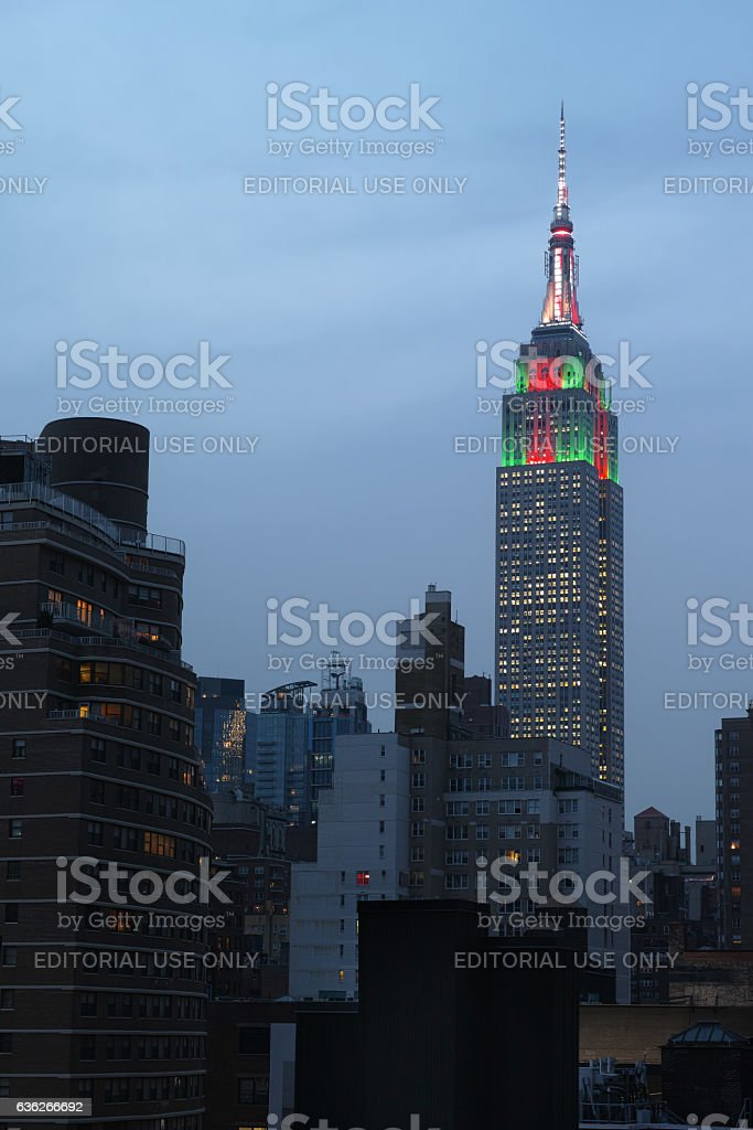 Top of Empire State Building in red and green christmas stock photo