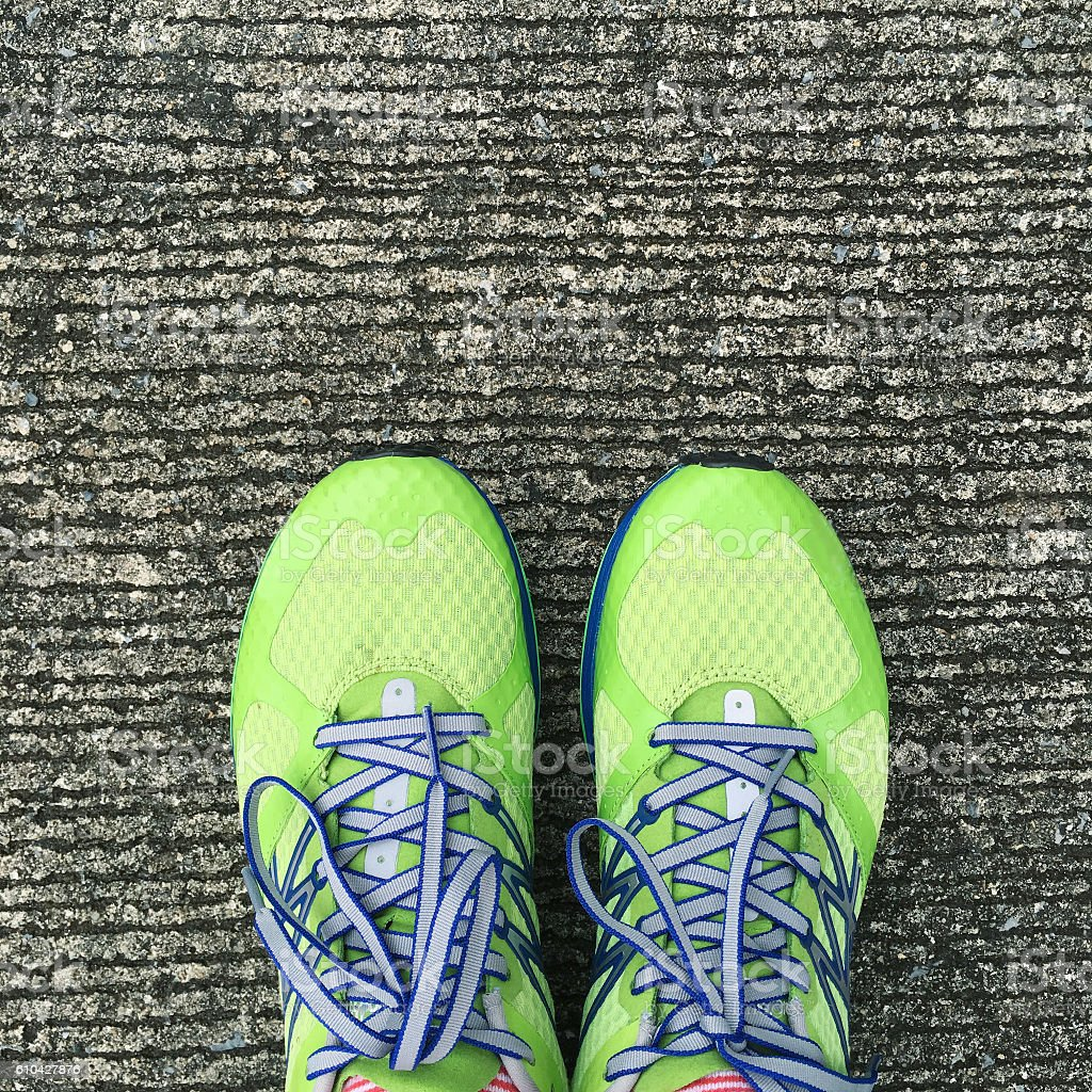 top of green exercise shoes with concrete background royalty-free stock photo