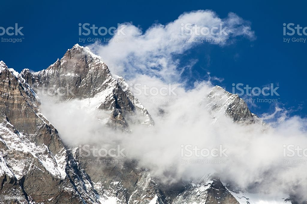 top of Lhotse and Nuptse with clouds on the top stock photo