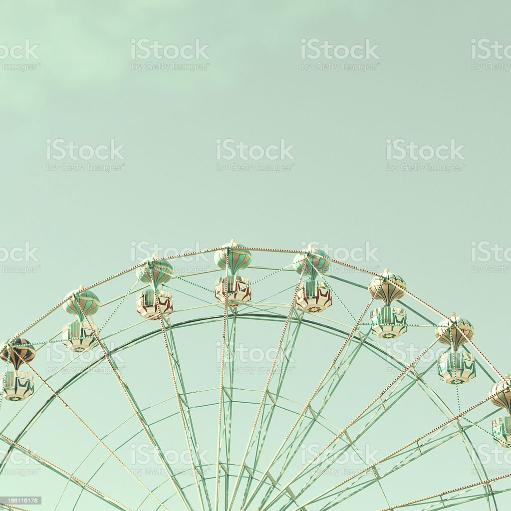Top of mint green ferris wheel against blue-green Sky stock photo