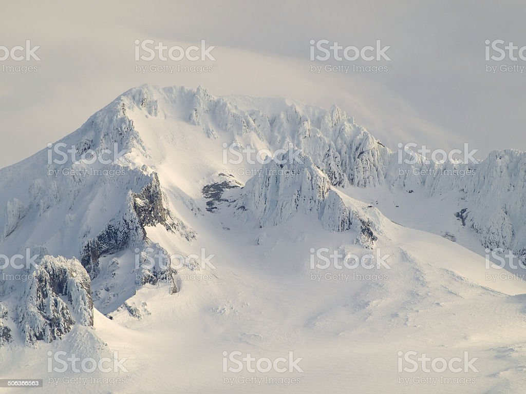 Top of Mt Hood Oregon Mountain Peak with snow clouds royalty-free stock photo