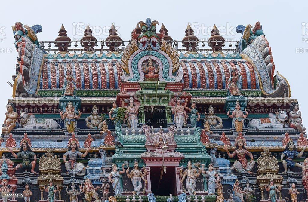 Top of Shiva temple gopuram in Kottaiyur. stock photo