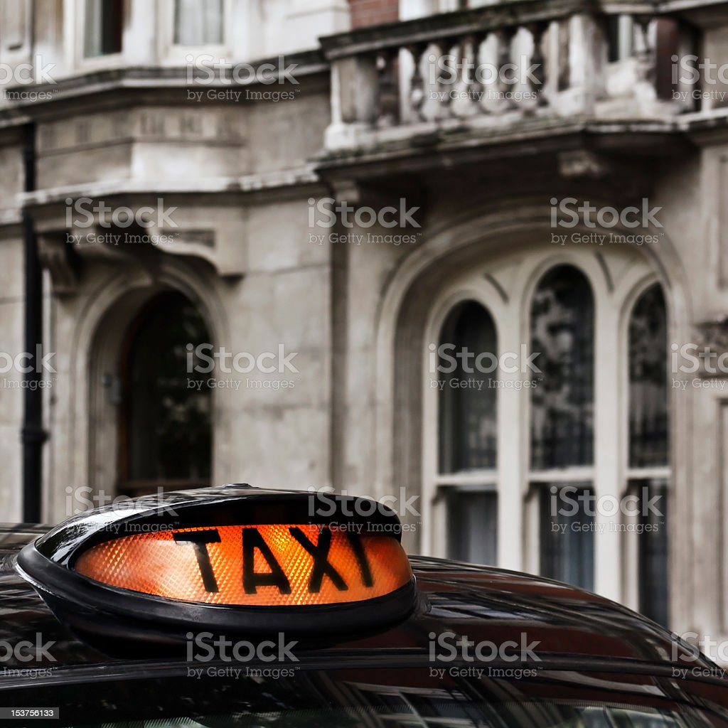 Top of taxi in front of old building royalty-free stock photo
