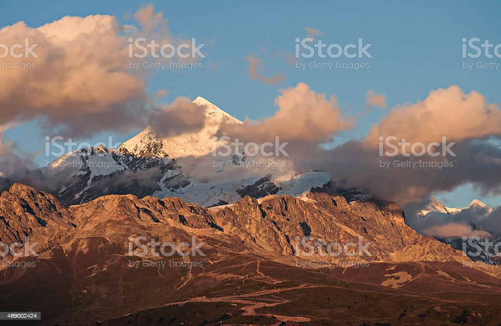 Top of Tetnuld at sunset in clouds stock photo