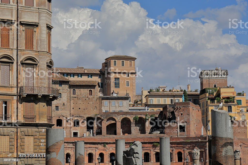 Top of the ancient columns and buildings of Trajan Forum stock photo