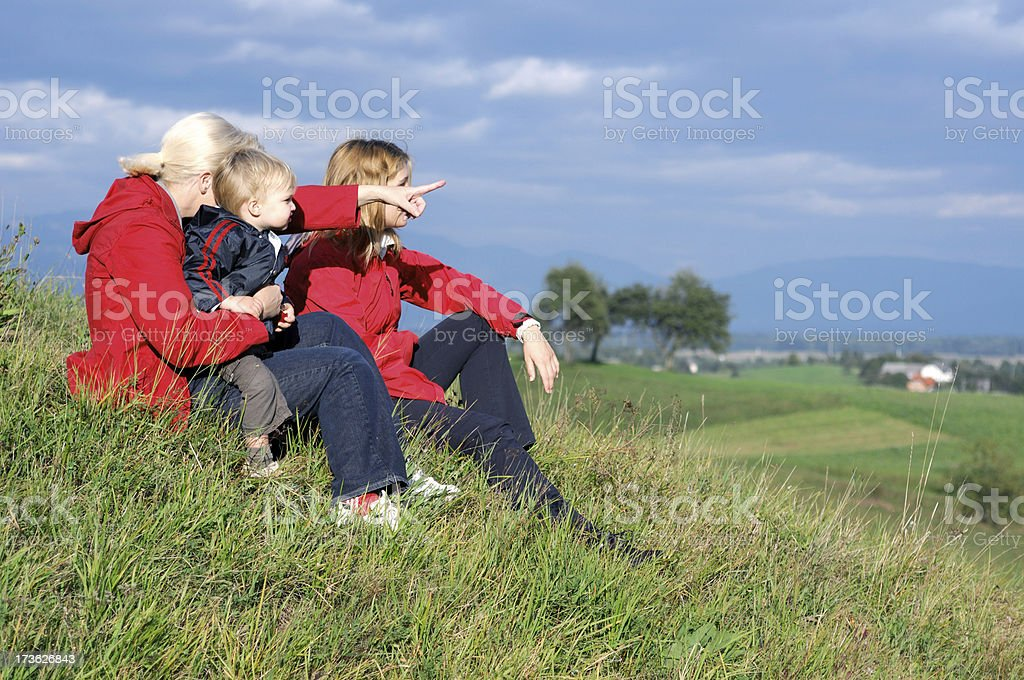 Top of the hill with family stock photo