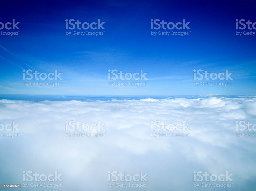Top of the world, over the clouds stock photo