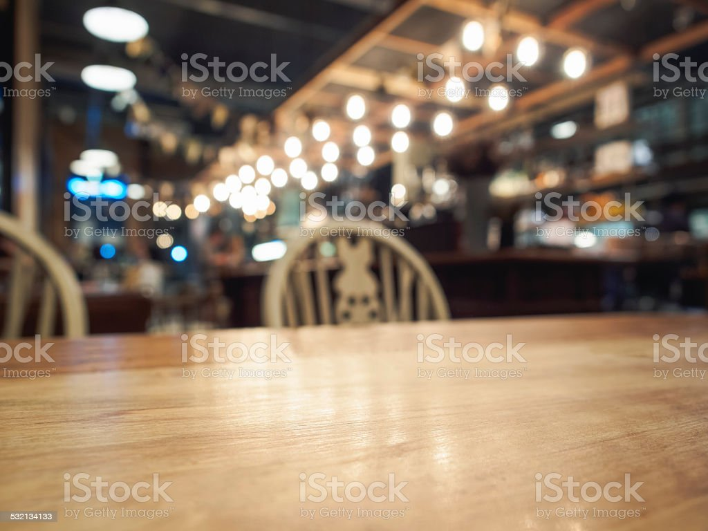 Top of wood table with Bar restaurant background stock photo