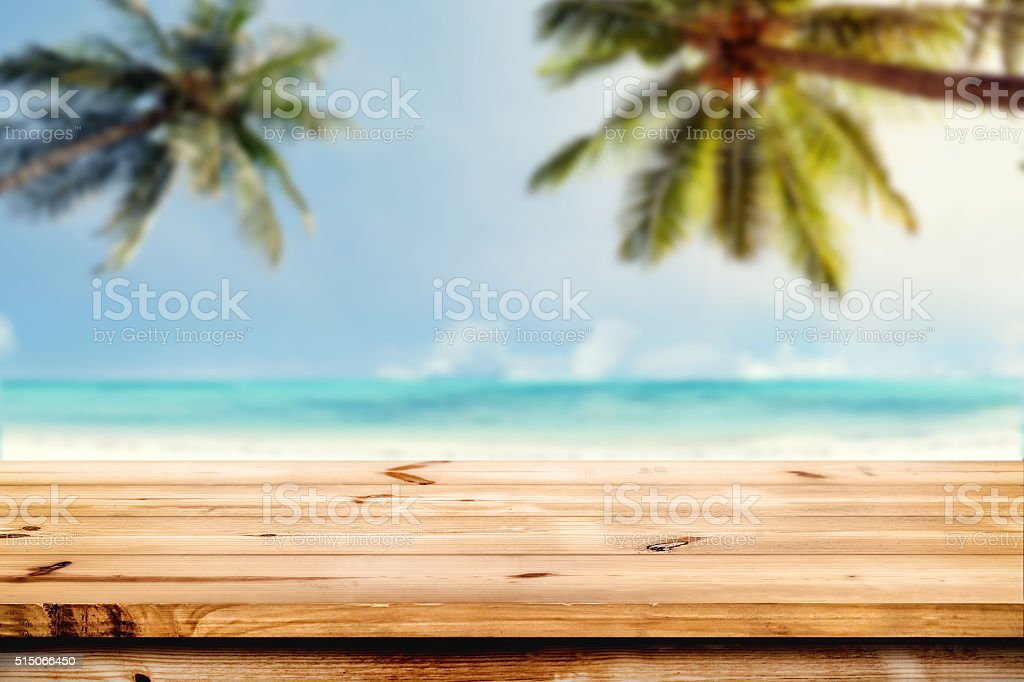 Top of wooden table on beach stock photo