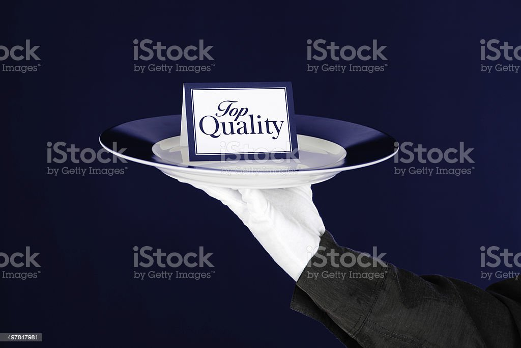 Top Quality Card On Platter Held By Waiter royalty-free stock photo