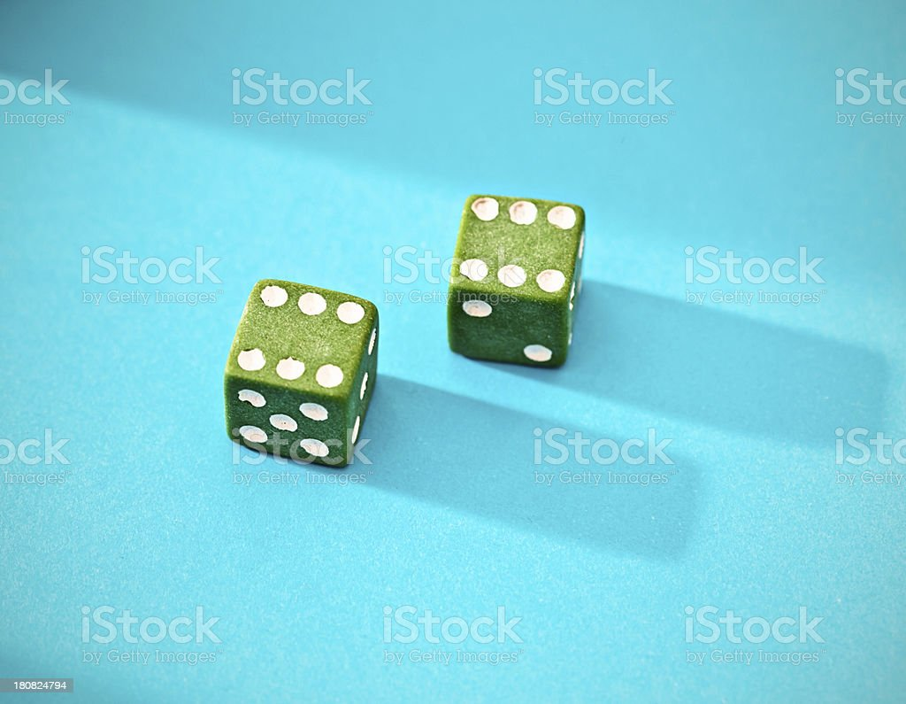 Top score of 12 showing on green dice royalty-free stock photo