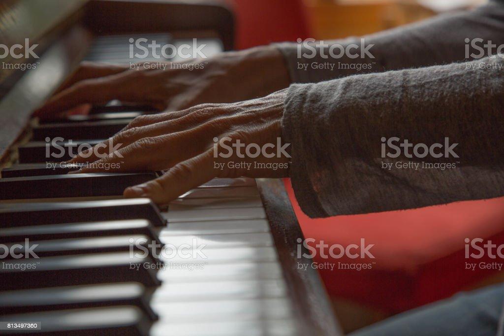 Top shot female musician playing piano stock photo