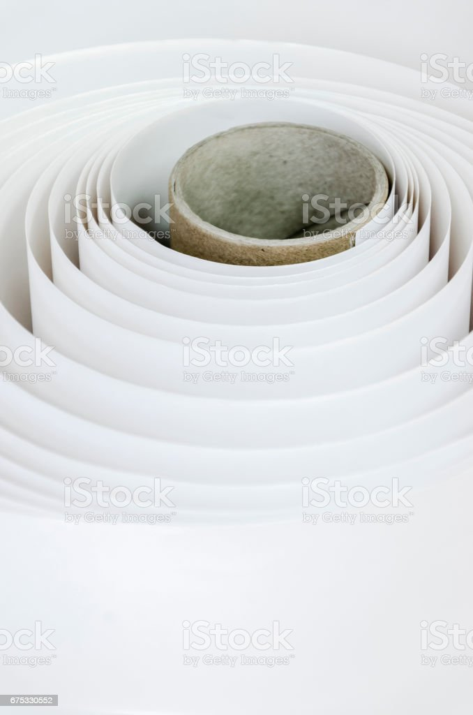 Top shot macro Paper roll swirl in a printshop, horizontal stock photo