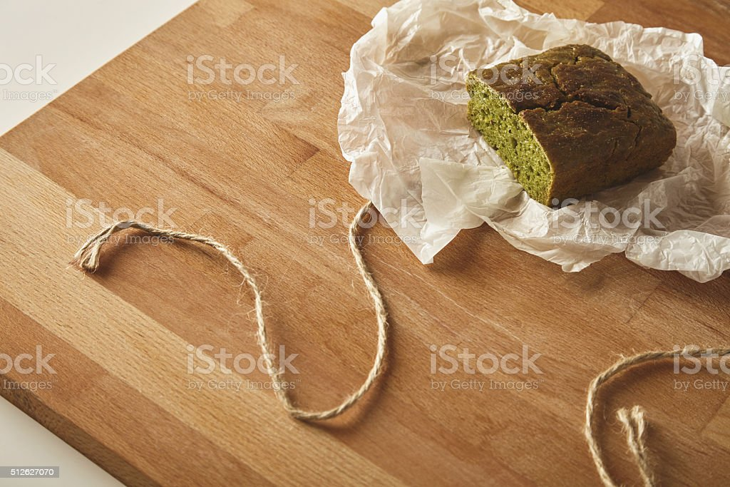 Top side view spinach bread isolated craft paper stock photo