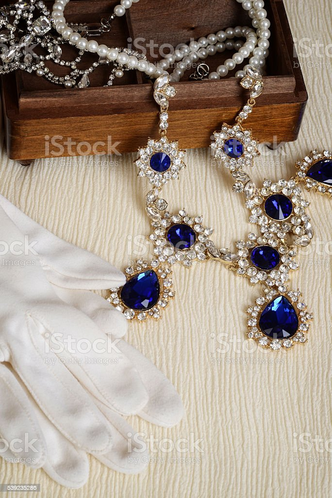 top view antique wood jewellery box and gloves stock photo