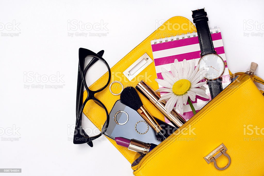 Top view bag with make up female fashion accessories. stock photo