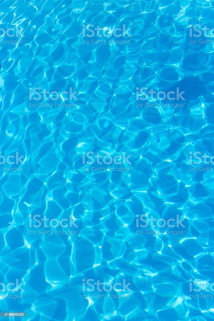 top view blue water caustics background stock photo