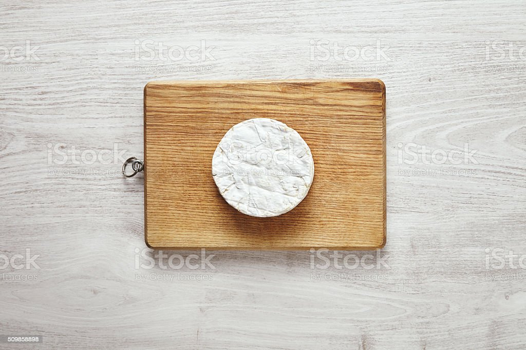 Top view camembert isolated on wooden table stock photo