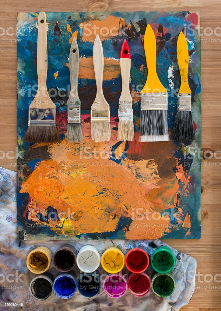 Top view close-up photo of a palette with paintbrushes stock photo